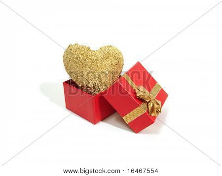golden heart on red gift box over white background