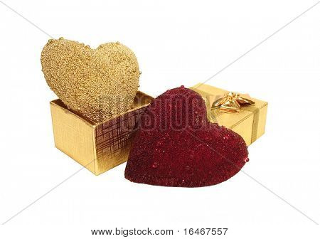 red and golden hearts on box over white background