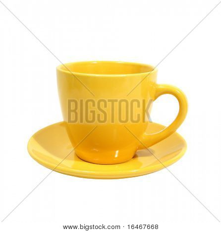 yellow cup with saucer over white background