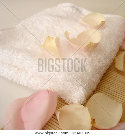 Towel and pink rose petals for spa