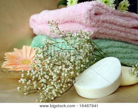 Spa essentials (soap and towels with pink flowers)