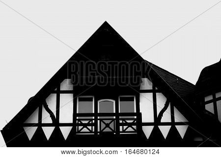 A triangular gable of an old half-timbered house.
