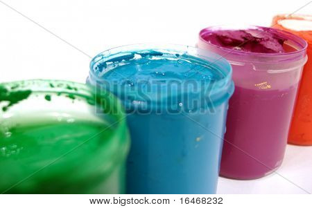many opened paint jars with gouache