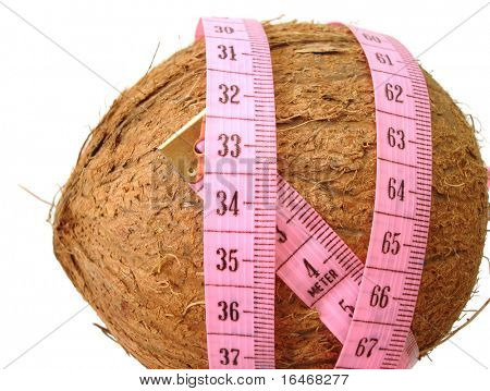 coconut with pink tape measure over white background (concept of health, diet)