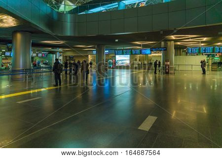 Moscow, Russia - December 25, 2016:  Tourists Look At A Display In The Hall Of Airport Vnukovo