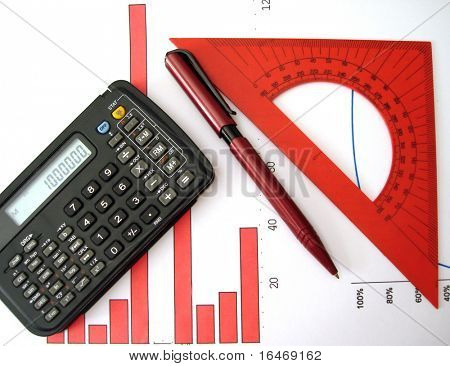 calculator, pen, ruler and red diagram of financial report