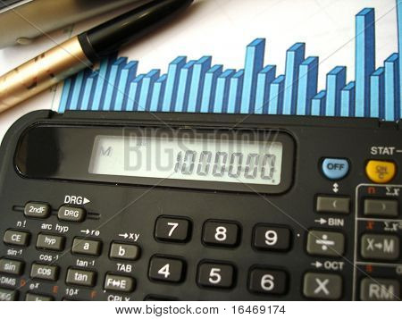 calculator, pen and blue diagram of financial report
