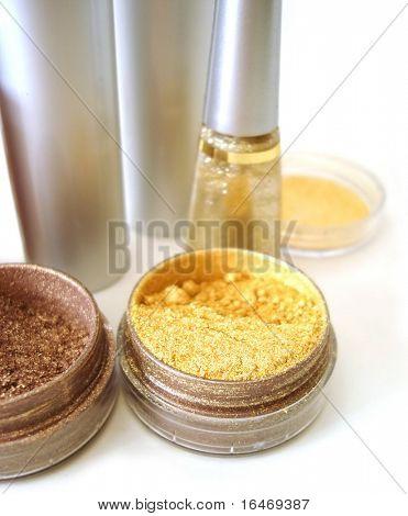 set for make-up (golden eyeshadows, rouge and nail polish)