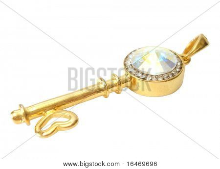 Golden key with brilliants on white background