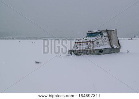 Frozen Danube River With Captured Boats And Seagulls
