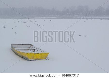 Ice Capured Yellow Boat On Frozen Danube River