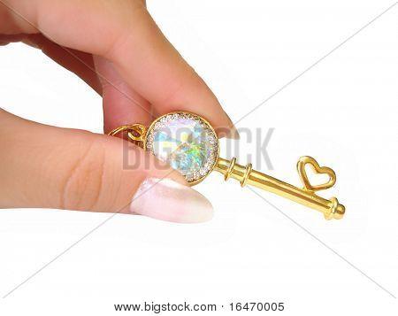 Goldene Schlüssel mit brillanten einerseits isoliert