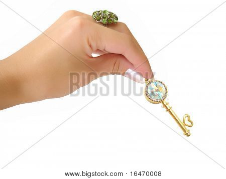 Golden key with brilliants on hand isolated