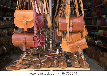 Leather bags and slippers on the market