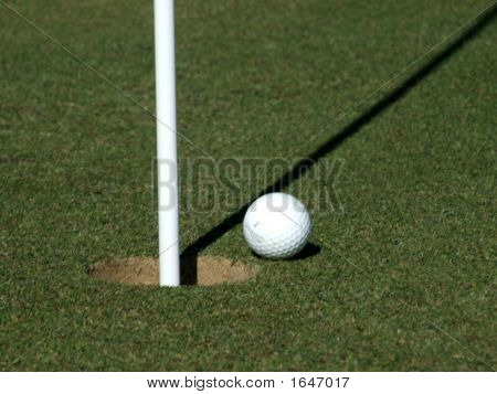 Golf Ball Next To A Flag