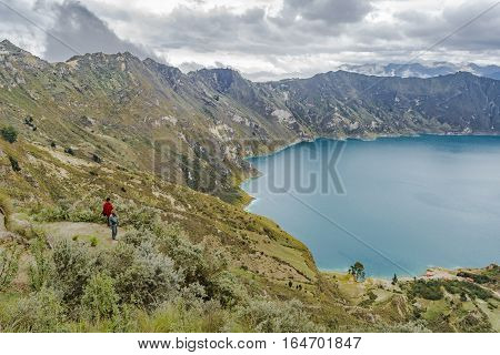 Two Indian Watching The View At Quilotoa Lake, Ecuador