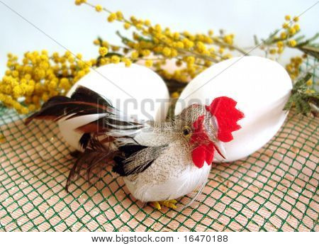 white eggs and cockerel with yellow spring flowers