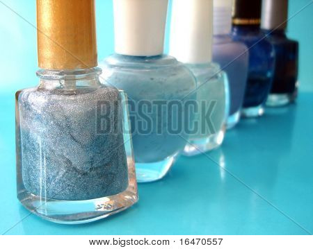 nail polish on blue background