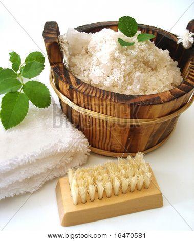washtub with bath salt, comb, towel and brush