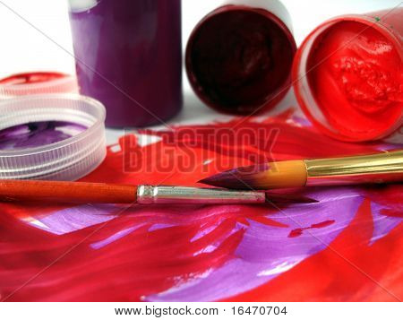 Brushes and red paint jar with gouache