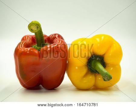 Two paprika on white background sweet pepper bell pepper