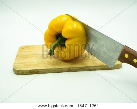 Paprika and knife on cutting board white background sweet pepper bell pepper