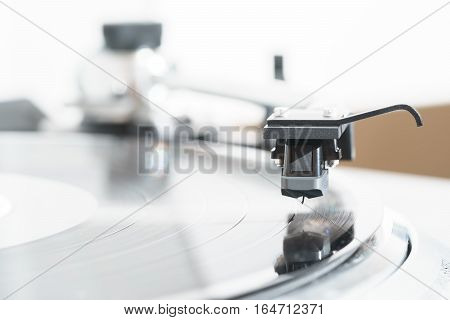 Turntable with black hi-fi Headshell Cartridge in action, dj, audio