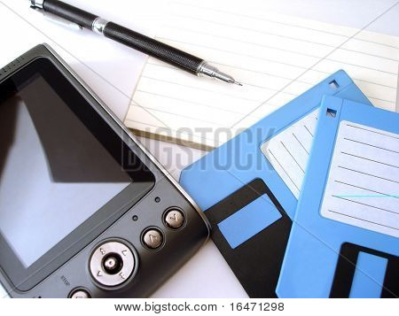 diskette, pen, notebook and pc