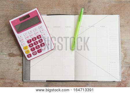 notebook monthly planner record for financial on table