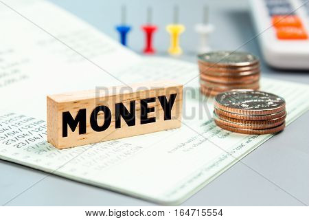 Text message Money on wooden with book bank, stacked coins. Finance concept