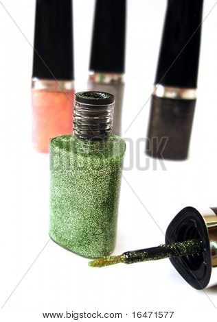 green nail polish or lipstick on white background