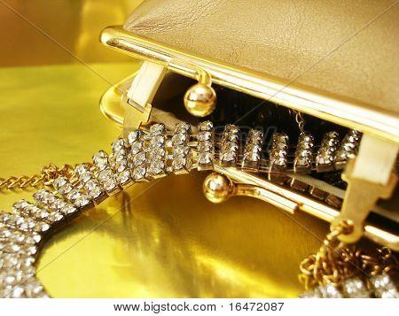 diamond necklace in golden womanish handbag