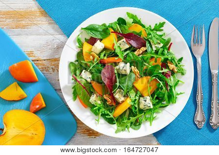 Persimmon, Blue Cheese, Spinach, Arugula, Lettuce Leaves And Walnuts Salad