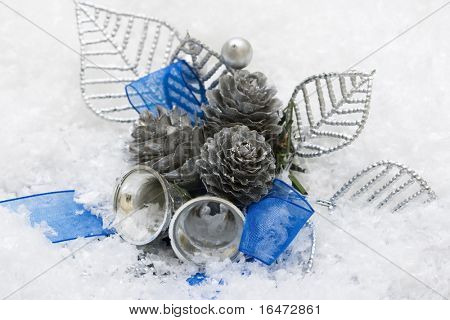 Christmas cone and bells on snow background
