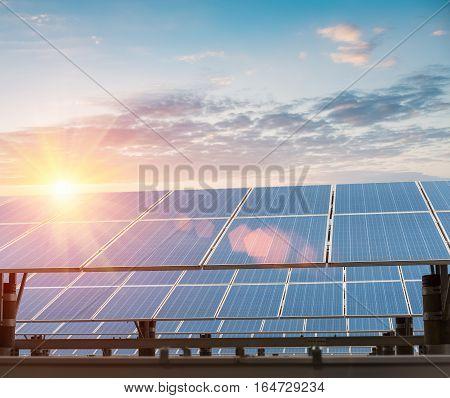 solar panels against a dusk sky new energy background
