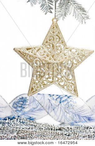 Star decoration on silver Christmas tree