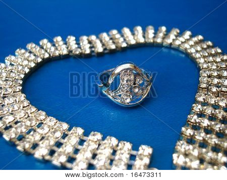 diamond necklace with ring on blue background