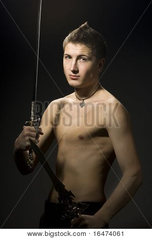 man with sword on black background