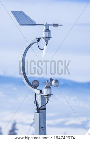 Anemometer used on meteorologic weather station. The anemometer is a device used for measuring wind speed and is a common weather station instrument.