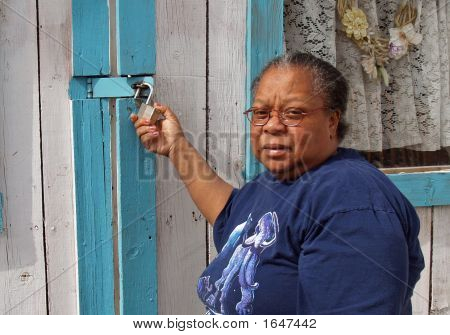 African American Woman Locking Her Garage Door
