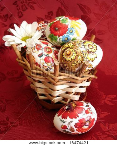 easter eggs on basket over red background