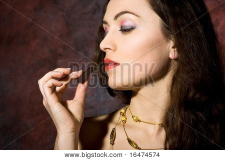 young beautiful woman eating chocolate