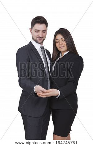 A young businesswoman and businessman are looking in their hands