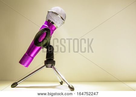 Save  Silver microphone in a dark blurry microphones background
