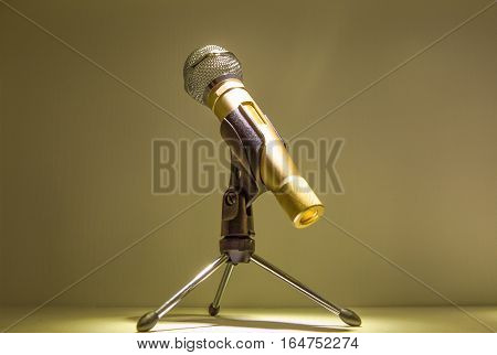 Silver microphone in a dark blurry microphones background