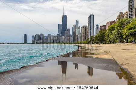 Chicago Illionois US July 17 2016: Chicago Skyline and people bathing in Michigan lake on a hot summer afternoon