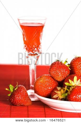 Table with strawberry and red wine
