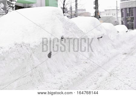 Full snow covered cars are seen during a heavy snowfall in the city