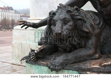 lion - a symbol of the city of Lyon.  Detail of the monument to King Louis XIV in Lyon, France