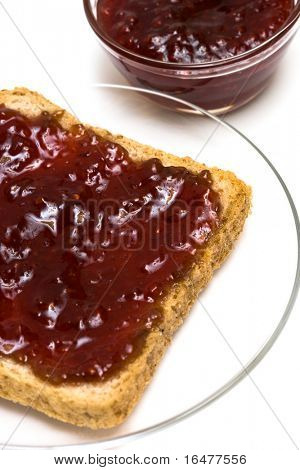 Breakfast of raspberry jam on toast